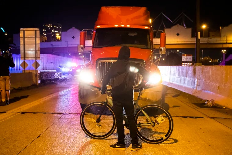 A protester stops traffic on the Delaware Ave. exit  on  I-95 south on Sept. 24, 2020 to protest the Breonna Taylor grand jury ruling