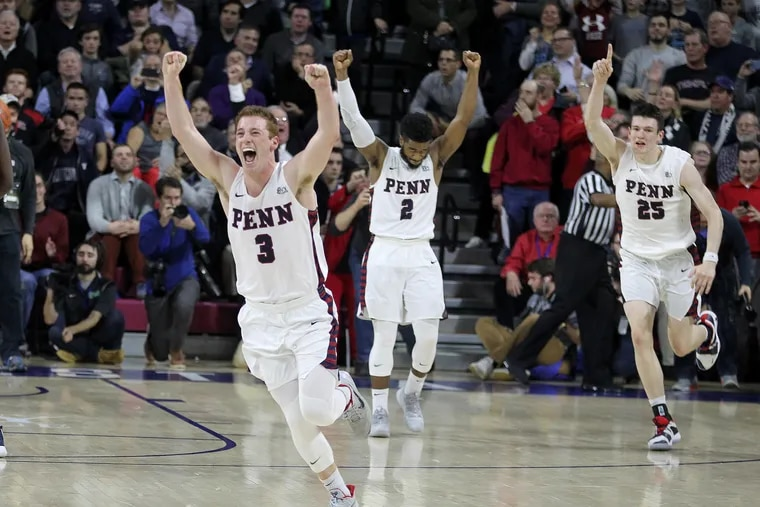 From left, Jake Silpe, Antonio Woods, and AJ Brodeur of Penn celebrating after their 78-75 victory over Villanova at the Palestra on Dec. 11.
