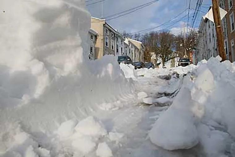 Cars left ruts in the snow on the unplowed 100 block of Jamestown St. in Manayunk.  ( David M Warren / Staff Photographer )