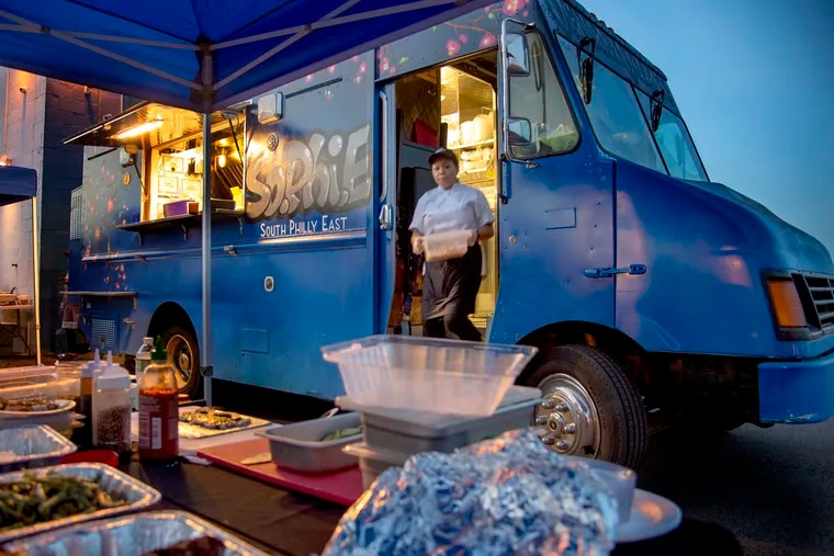 Chef Zing Thluai works in the South Philly East (SoPhiE) food truck at Novick Farm October 10, 2018. The nonprofit SEAMAAC is helping immigrants and refugees. They bought a food truck so immigrants who hope to open their own food business can try it out at the food truck first. TOM GRALISH / Staff Photographer