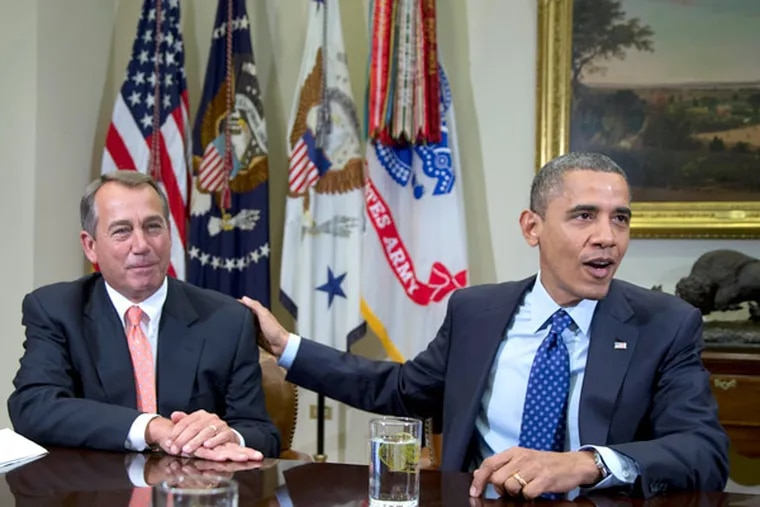In this file photo, President Barack Obama acknowledges House Speaker John Boehner of Ohio while speaking to reporters in the Roosevelt Room of the White House in Washington. (AP Photo/Pablo Martinez Monsivais)