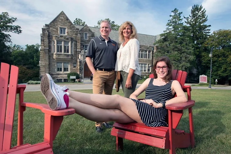 Rosemont freshman Isabella Moraschi, with her parents Lewis and Mary Beth Moraschi in front of Good Counsel Hall on campus. The Moraschis, from Marlton, were attracted by the school's 43 percent tuition cut.