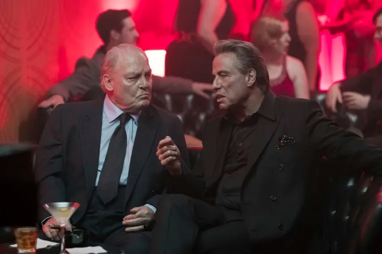 """Stacy Keach, left, and John Travolta in a scene from """"Gotti.'"""