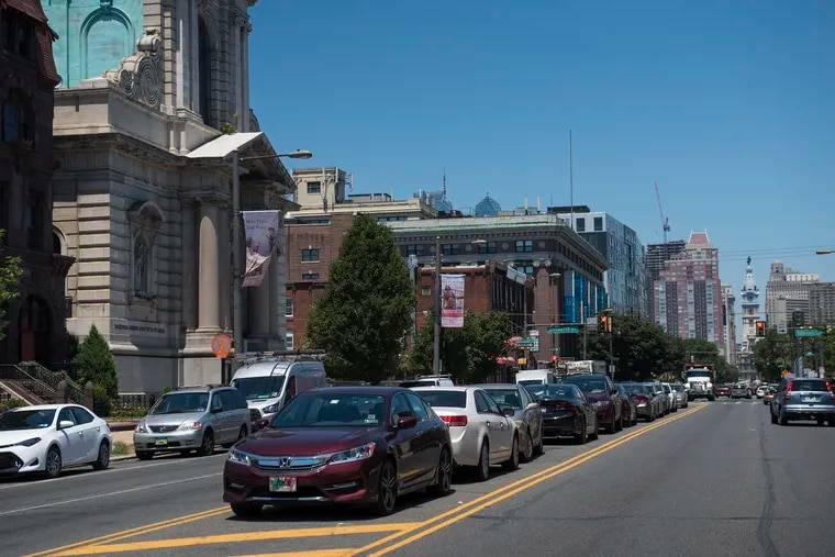 Cars are parked in the middle of Broad Street between Ellsworth and Federal Streets. A study released this week found that Philadelphia is estimated to have more than 2 million parking spots, outnumbering the city's population.