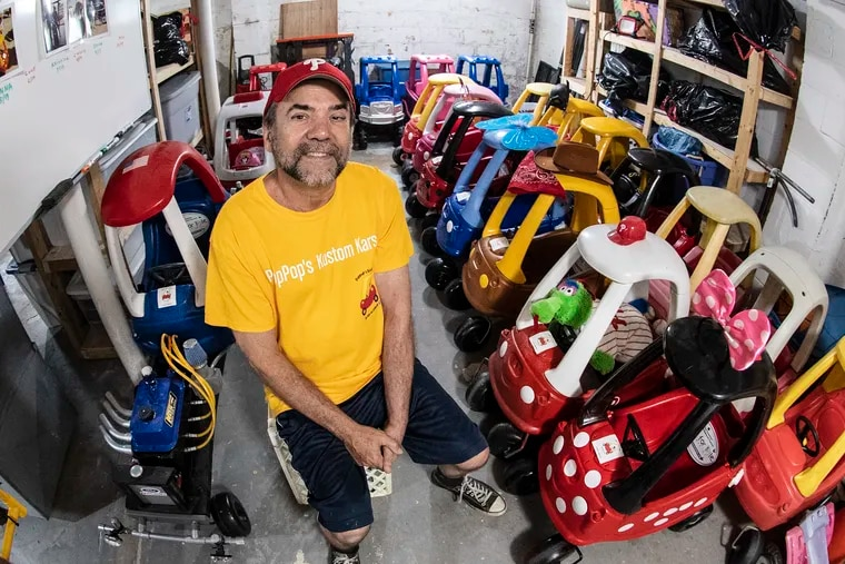 Rich Nardiello is photographed with his plastic wheels project collection at his home in Sewell, NJ. Thursday, June 20, 2019. Rich, converts old Little Tikes Cozy Coupes into modern micro machines for sick kids.