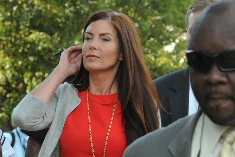 Pa. Attorney General Kathleen Kane walks out of the Montgomery County Courthouse in Norristown after her preliminary hearing in August. (CLEM MURRAY/STAFF PHOTOGRAPHER)