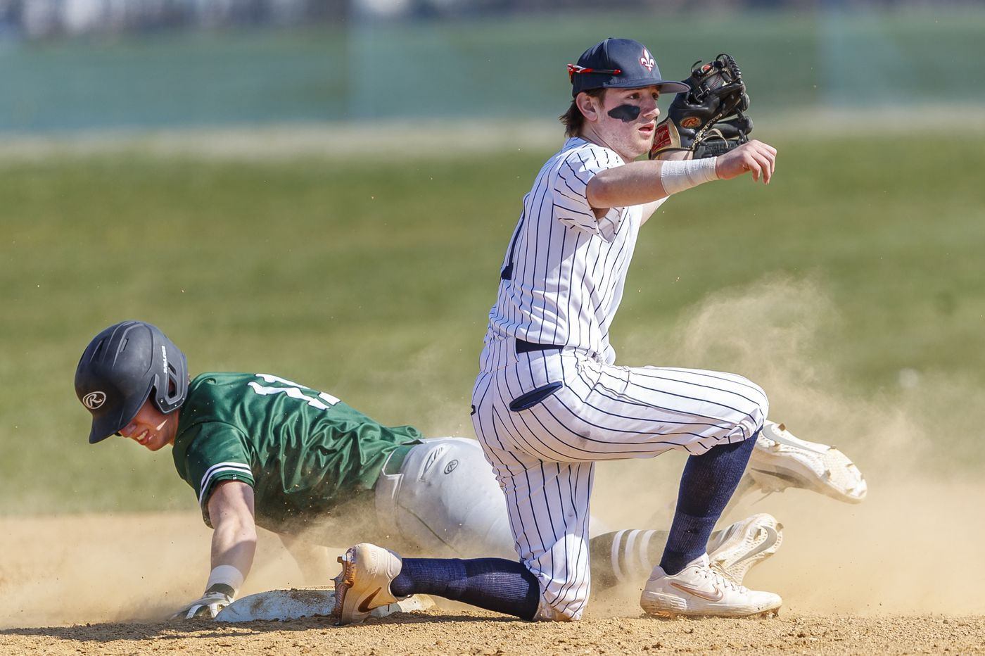 It's a quick transition from winter sports to baseball for a pair of Holy Ghost Prep players
