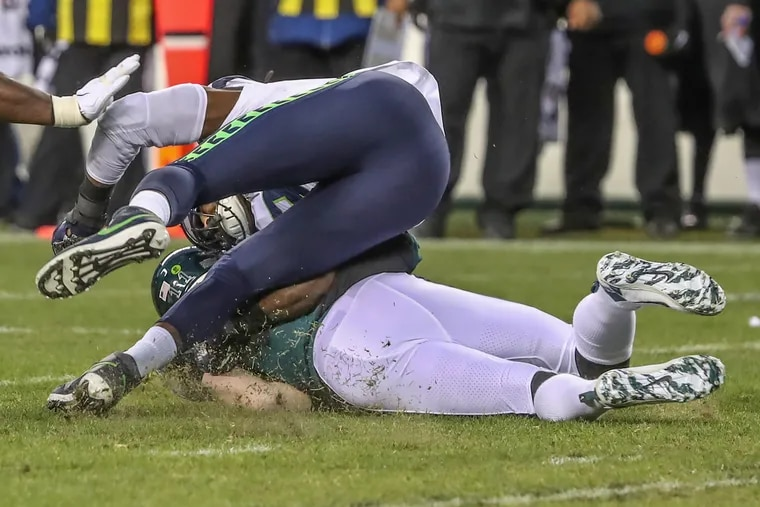 Seattle's Jadeveon Clowney slammed into the head of Eagles quarterback Carson Wentz, injuring him and taking him out of the game in the first quarter.