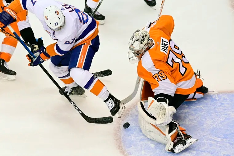 Flyers goaltender Carter Hart makes a save against New York Islanders left winger Anders Lee  during an Eastern Conference playoff game in Toronto on Sept. 5.