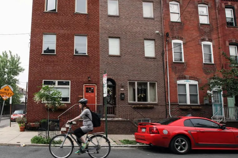 """Along Mifflin Street, one resident said, """"asking prices $275,000 to $325,000 are the norm."""" (STEVEN M. FALK Staff Photographer)"""