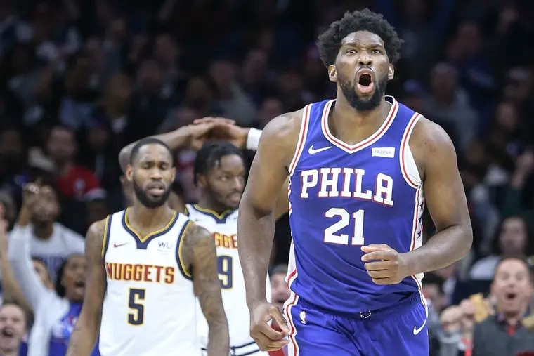 Joel Embiid roars after making a third-quarter basket against the Nuggets.