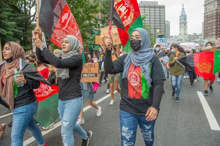 Members of the Afghanistan diaspora living in the Philadelphia area gathered at City Hall and then marched to the Philadelphia Museum of Art on Saturday. They sought to draw attention to the plight of Afghan refugees.