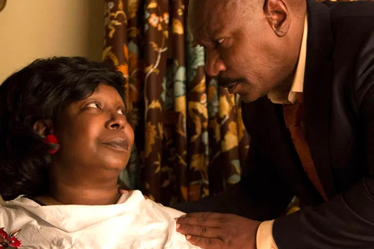 """Whoopi Goldberg with Ving Rhames, as her estranged husband., in a scene from Lifetime's """"A Day Late and a Dollar Short"""""""