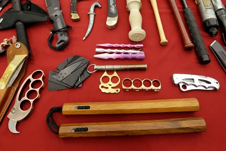 FILE - In this April 6, 2017, file photo, objects confiscated from passengers' carry-on luggage, including nunchucks, bottom, are displayed at Seattle-Tacoma International Airport in SeaTac, Wash. A federal court says New York's ban on nunchucks, the martial arts weapon made famous by Bruce Lee but prohibited in the state for decades, is unconstitutional under the Second Amendment.