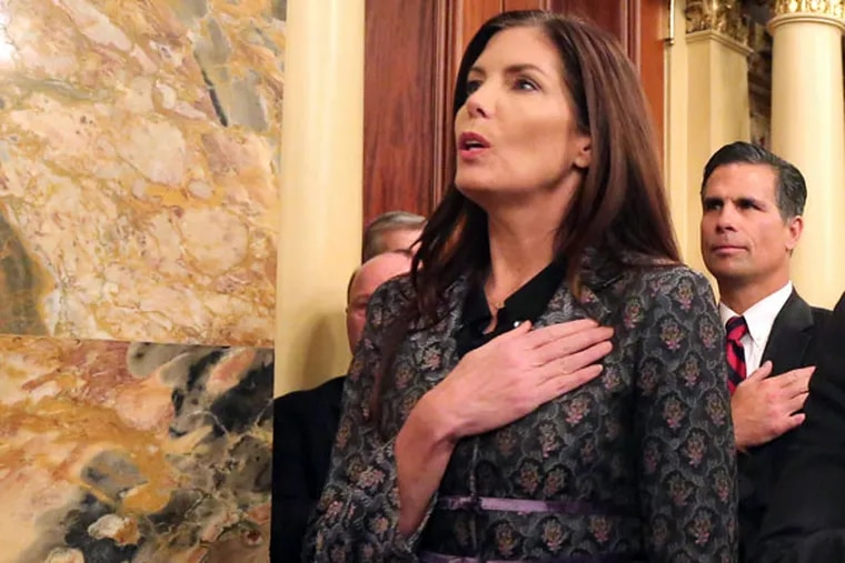 Attorney General Kathleen Kane recites the Pledge of Allegiance while attending the state House of Representatives' swearing-in in Harrisburg on Tuesday, January 6, 2015. ( DAVID SWANSON / Staff Photographer )