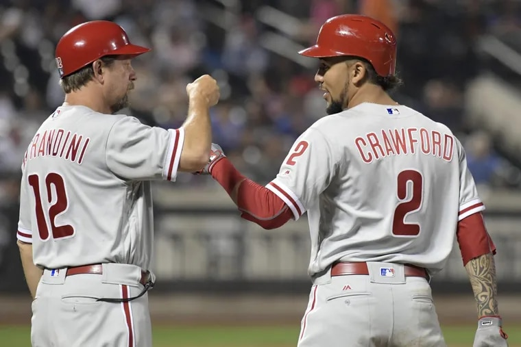 Mickey Morandini (left) was the Phillies' first-base coach for the last two seasons and has spent the last seven years coaching in the organization. His fate, like the rest of the staff, remains unclear.