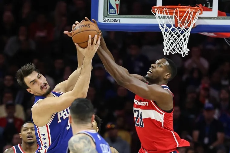 Dario Saric, left, vies for a rebound with the Wizards' Ian Mahinmi during the third quarter Wednesday.