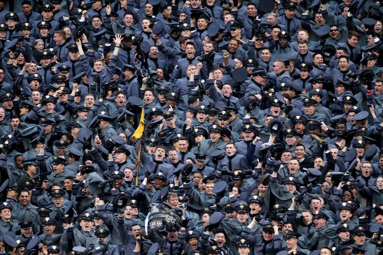 Army cadets celebrate a touchdown during the 120th Army-Navy game at Lincoln Financial Field in South Philadelphia on Saturday, Dec. 14, 2019.