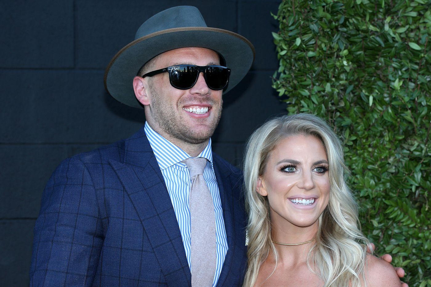 Zach Ertz and his wife, Julie, pose for photos while entering the Eagles' Super Bowl championship ring ceremony in South Philadelphia.