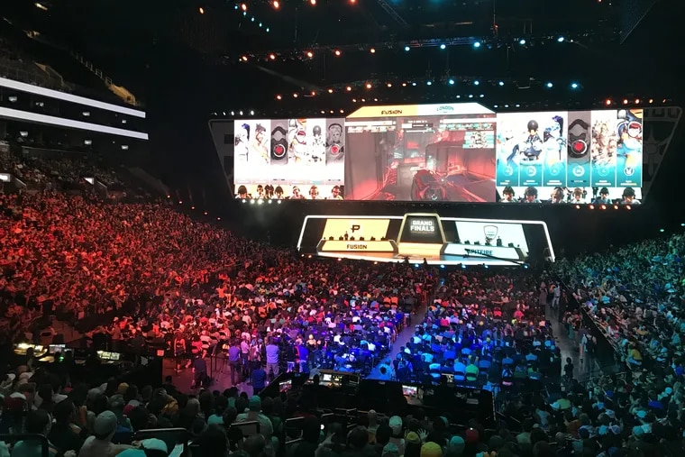 Fans of the e-sports Overwatch League watch as the sixth-seeded Philadelphia Fusion compete against the fifth-seeded London Spitfire in the Overwatch League Grand Finals at the Barclays Center in New York City on Saturday, July 28. Philadelphia lost to London 2-0 to finish second in the league and take home $400,000 in prize money.