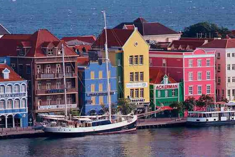 The picture-pretty rainbow of buildings on Willemstad's waterfront street the Handelskade. The strip has been designated a UNESCO World Heritage site.