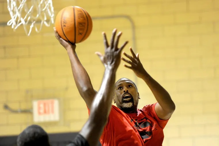 Former South Philadelphia High School and La Salle University star Kareem Townes shoots during an over 40 basketball championship game at the Feltonville Rec Center November 21, 2017. His friends are trying to get Townes into the Big Five Hall of Fame, which might be tough.