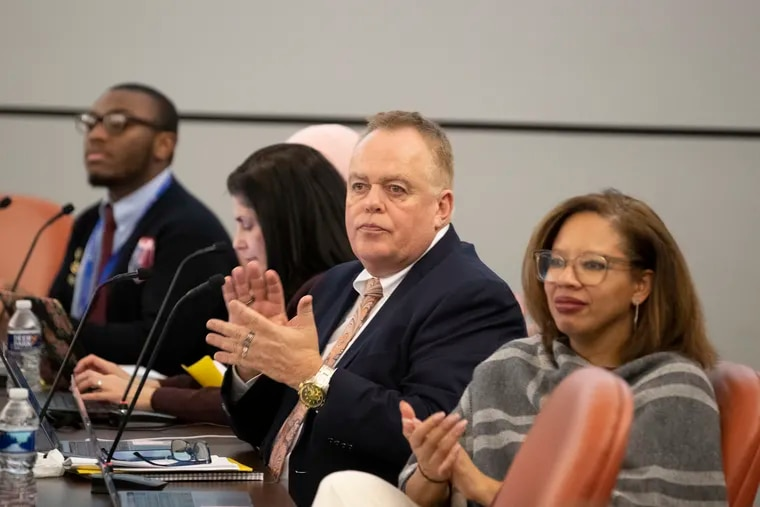 Christopher McGinley (center) is not seeking reappointment to the Philadelphia school board. McGinley, a district graduate who was also a teacher and principal in the school system and superintendent in Lower Merion, is leaving for personal reasons.