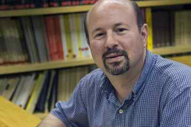 """Penn State climatologist Michael Mann, who created the """"hockey stick"""" graphs showing a spike in world temperatures in the 20th century. The stolen and leaked e-mails generating the most discussion focus on these graphs. (Greg Grieco)"""