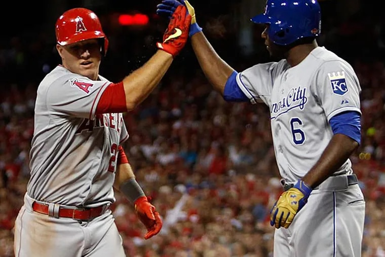 American League outfielder Mike Trout (27) of the Los Angeles Angels high fives American League outfielder Lorenzo Cain (6) of the Kansas City Royals after scoring against the National League during the fifth inning of the 2015 MLB All Star Game at Great American Ball Park. (Frank Victores/USA Today)
