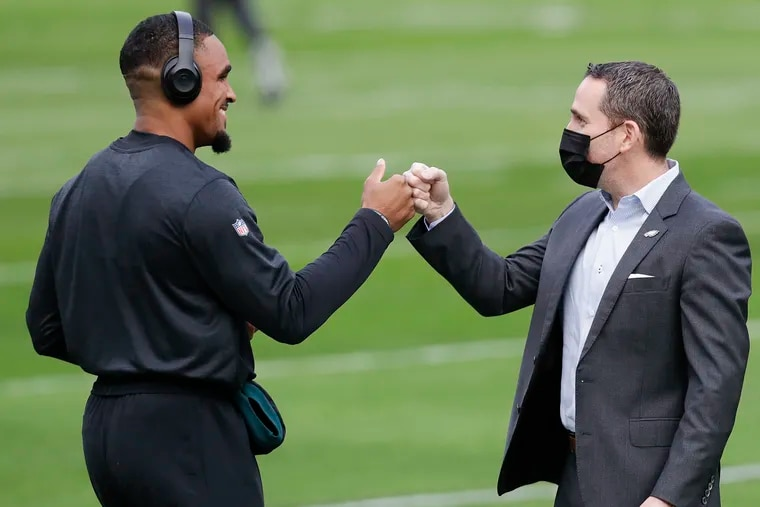 Eagles quarterback Jalen Hurts met with Howie Roseman during warmups before the Eagles played the New Orleans Saints on Dec. 13, 2020.