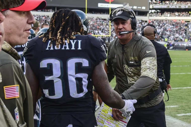 Doug Pederson with Jay Ajayi. There was a lot to celebrate Sunday. CLEM MURRAY / Staff Photographer