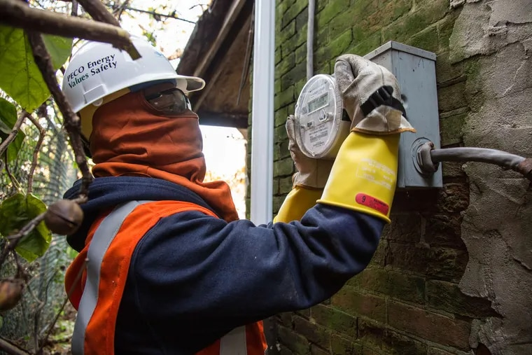 Peco technician Harry Christian, in protective gear, installs a smart meter in 2015, when Peco's deployment of 1.7 million meters was nearly completed.