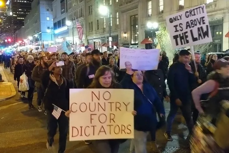 Hundreds of protesters marched Thursday night in Center City to show support for special counsel Robert Mueller.