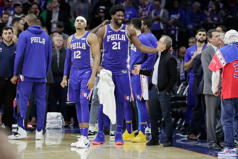 Joel Embiid (21) with Sixers owner Josh Harris in 2019. Harris just signed Embiid to a $196 million extension.