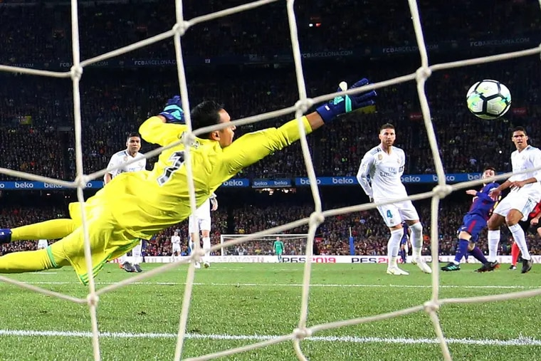 Barcelona's Lionel Messi scores their second goal past Real Madrid's Keylor Navas in a La Liga game on May 6 in Spain.