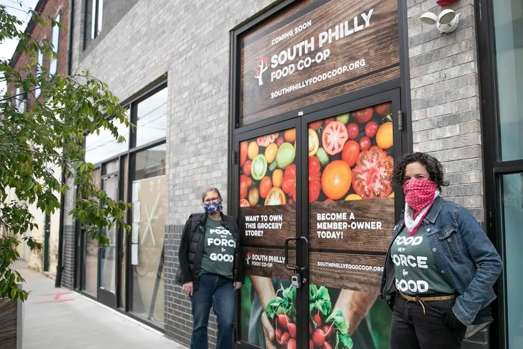Leigh Goldenberg, South Philly Food Co-op board president (right) and Lori Burge, general manager, pose for a portrait outside of the South Philly Food Co-op in South Philadelphia on Tuesday, May 12, 2020. The South Philly Food Co-op has been in the works for 10 years. They were about six weeks from completing work on their grocery store in March when the pandemic shut down construction. Work is getting underway again, and they hope to open the store by the end of the year.