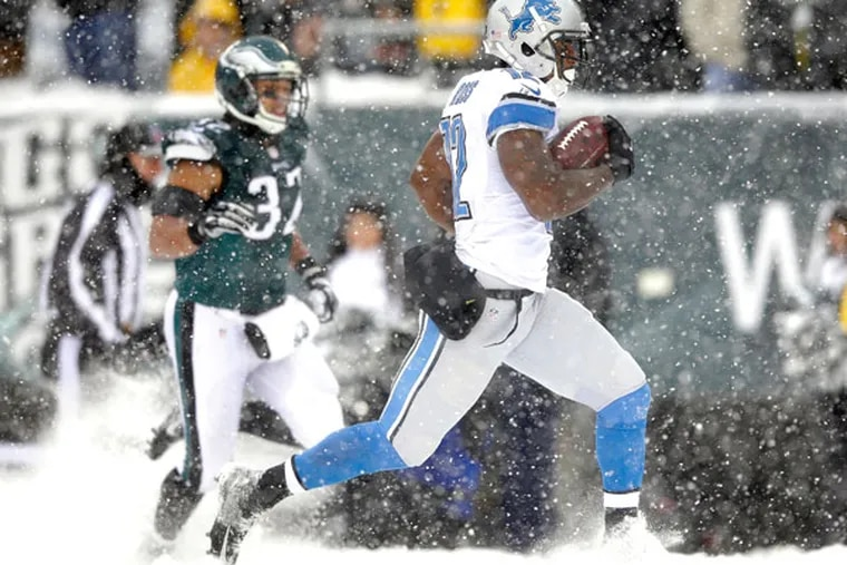 The Lions' Jeremy Ross, right, returns a punt for a touchdown as Philadelphia Eagles' Chris Polk gives chase during the second half of an NFL football game, Sunday, Dec. 8, 2013, in Philadelphia. (Michael Perez/AP)