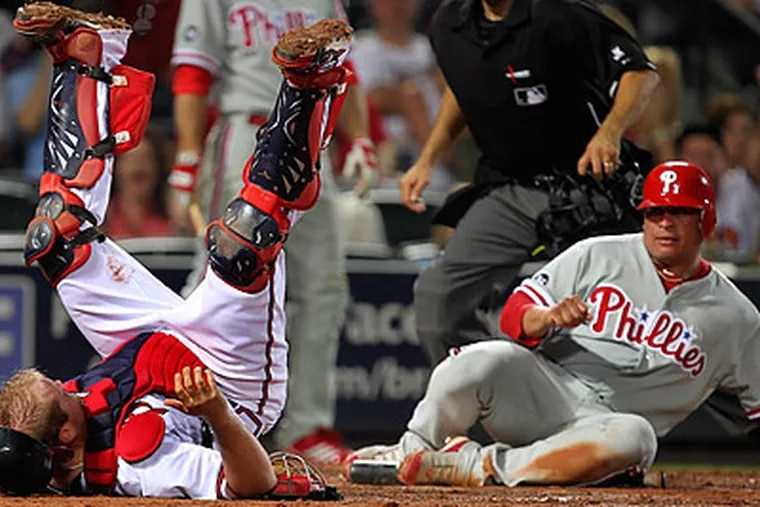 Carlos Ruiz got caught at the wrong end of a 5-4-2 double play in the seventh inning. (John Bazemore/AP)