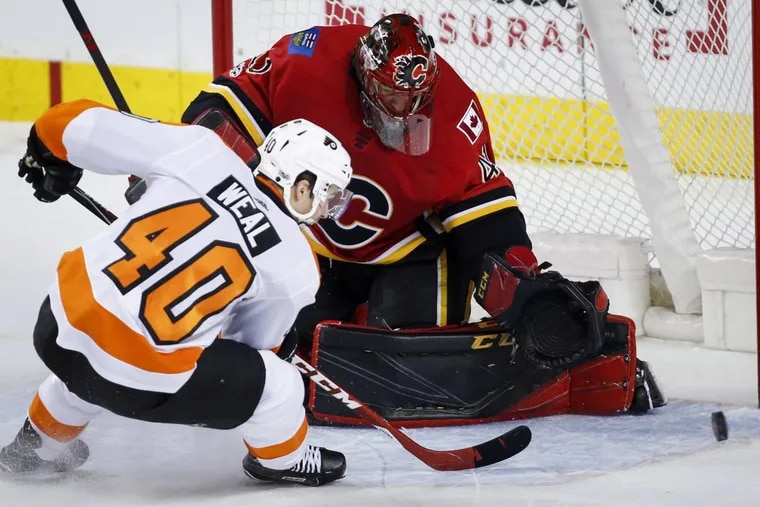 The Flyers' Jordan Weal has his shot stopped by Calgary Flames goalie Mike Smith during the first period.