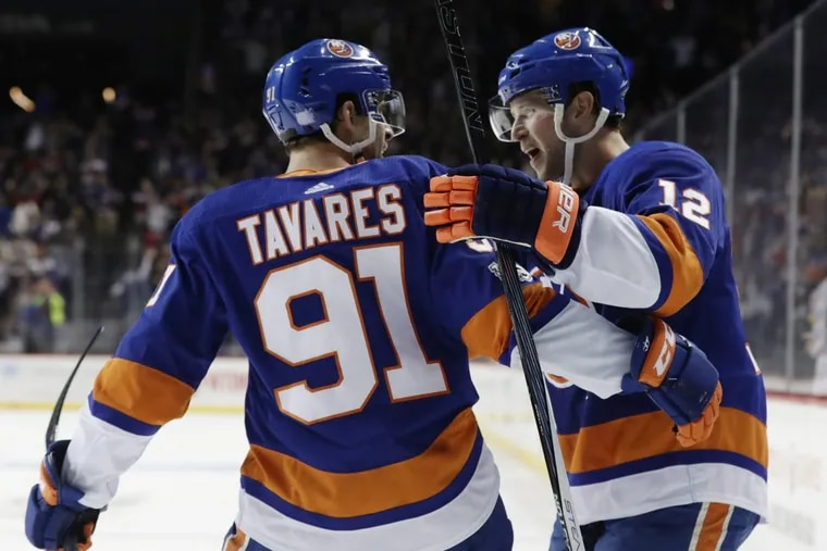 New York Islanders right wing Josh Bailey (12) celebrates with teammate John Tavares (91) after scoring the winning goal in overtime Wednesday.