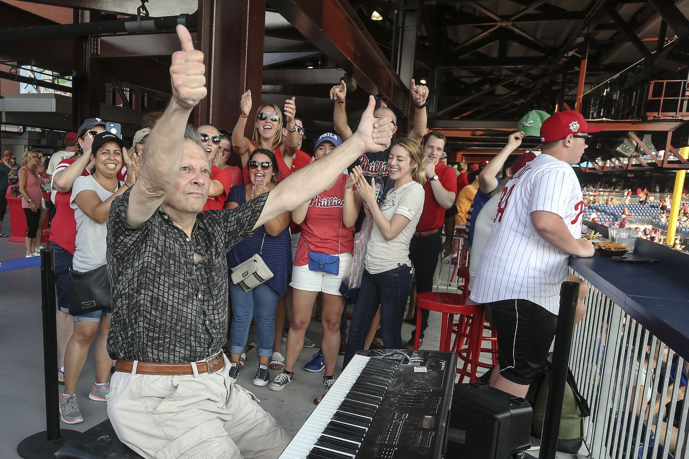 Church organist by day, Phillies organist by night