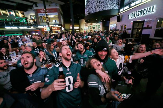 'We're going to win the Super Bowl again': Fans cheer playoff-bound Eagles