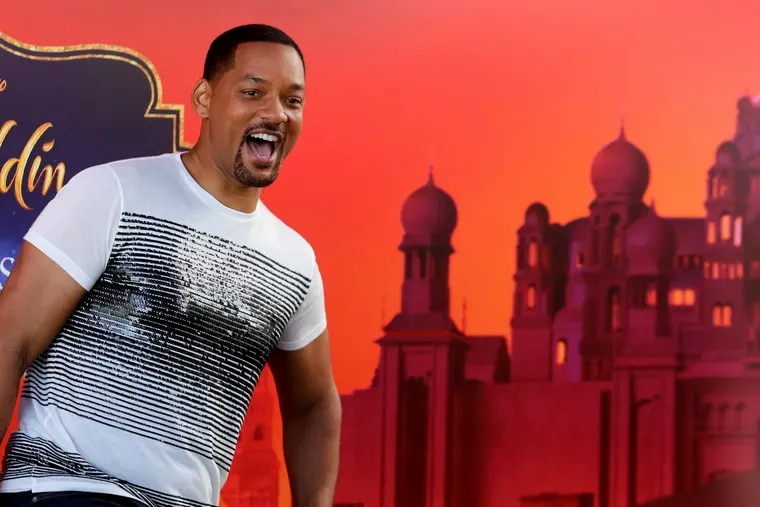 """U.S. actor Will Smith reacts during a news conference with director Guy Ritchie and stars Mena Massoud and Naomi Scott, ahead of the regional launching of Disney's live-action """"Aladdin,"""" in the Jordanian capital Amman, Monday, May 13, 2019. The film opens in Middle East theaters May 23, 2019. (AP Photo/Raad Adayleh)"""