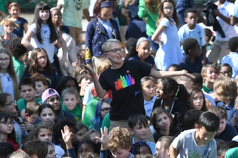 Students cheer during a gathering celebrating Greenfield Elementary's status as a U.S. Department of Education Blue Ribbon award winner. Locally, 11 schools received the honor. 348 schools nationwide won the prize.
