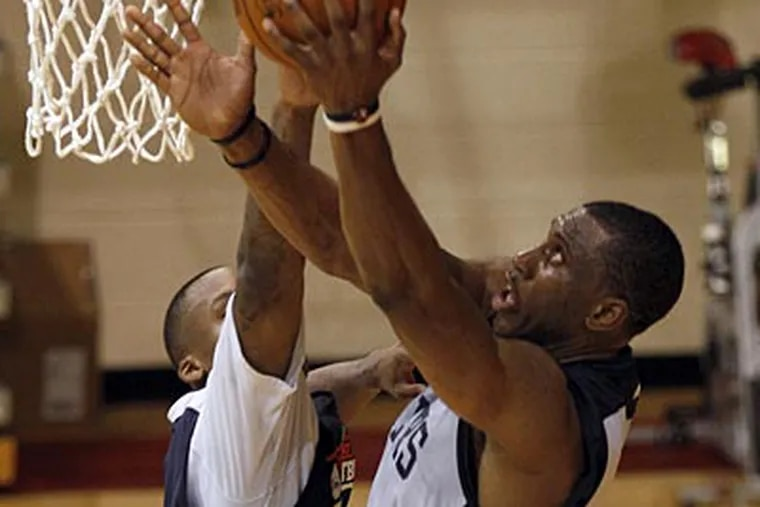 Thaddeus Young goes up for a basket over Maalik Wayns at training camp. (Yong Kim/Staff Photographer)