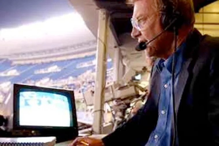 At Veterans Stadium, Harry Kalas follows the action. He arrived here in 1971 and became a fan favorite with his distinctive home-run calls. He had one of the most respected and recognizable voices in baseball. (Charles Fox / Staff Photographer)