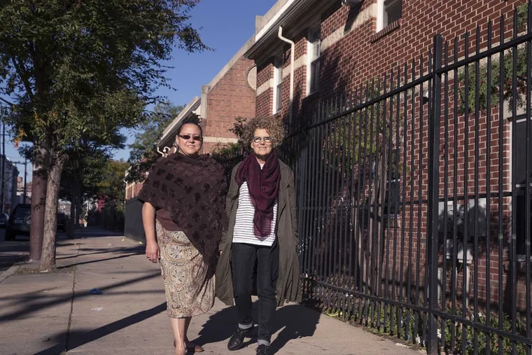 Norma Santiago (left), a board member at Women's Community Revitalization Project who is also a tenant at the first development the project built, and project CEO Nora Lichtash.
