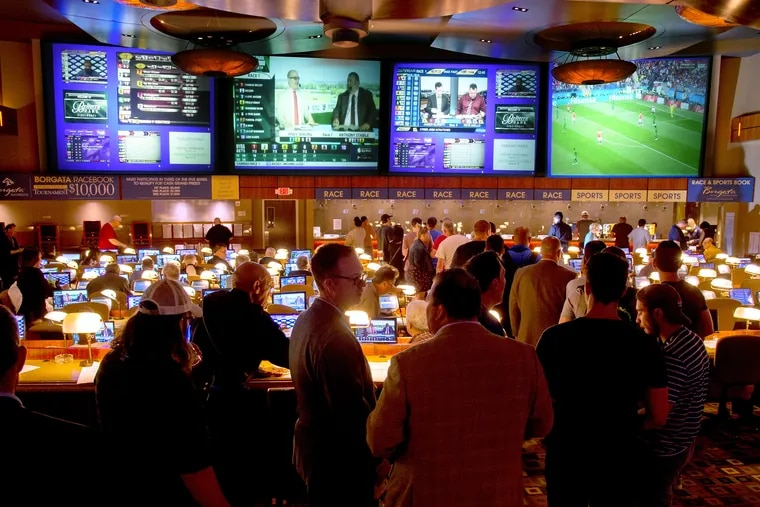 Bettors line up at the Borgata sportsbook in Atlantic City. Sports betting has gotten off to a slower start in Pennsylvania, whose tax rate is about four times higher than New Jersey's.