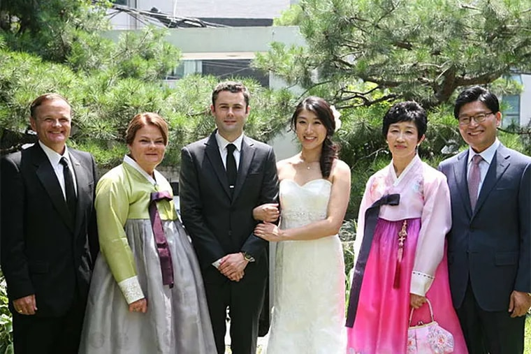 At the couple's first wedding, American-style, in Korea: (from left) his parents, Bill and Coleen Dunn; groom Patrick Dunn and bride Erica Park; and her parents, Gui Hye Park and Hyeon Cheol Park. The couple held their second wedding a few months later in Exton. (Cosa Wedding)