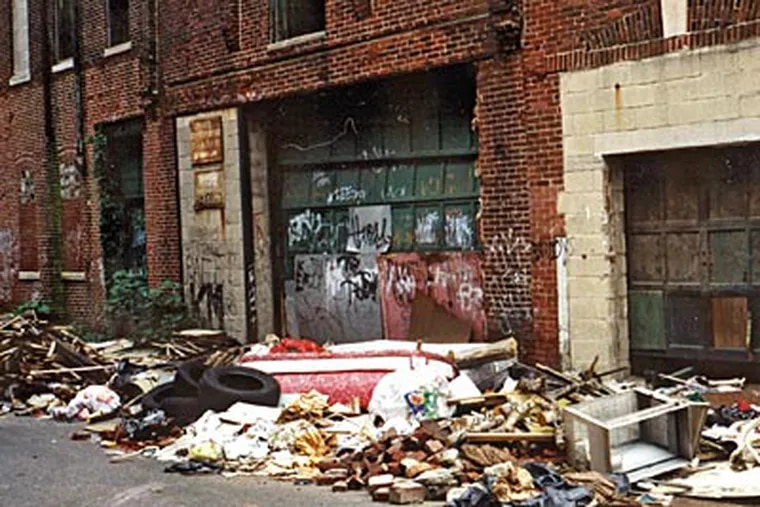 This 2000 photo shows trash and debris dumped outside two blighted buildings on the 2200 block of Alter St. (Andrew Jevremovic)